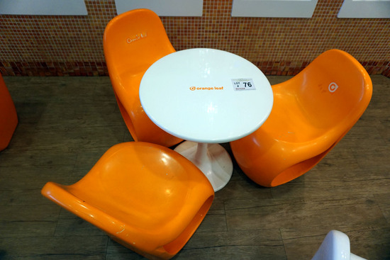 Round Plastic Table & (3) Orange Chairs.