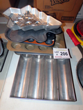 Assorted Cake Pans & Stainless Steel Silverware Holder.