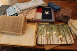 (86) Lot of Assorted Table Linens and trays