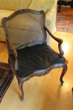 Carved Continental Arm Chair with Woven Wicker Seat and Back with Leather Cushion