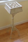 White Ornate Cast Metal Stand