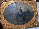 Civil War Tintype Photograph of a mounted soldier with sword drawn