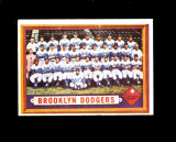 1957 Topps Baseball Card #324 Brooklyn Dodgers Team. Has Crease on front To