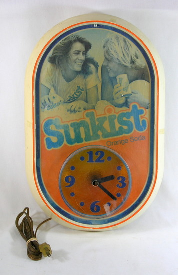 1970s Sunkist Lighted Advertising Electric Clock. Light  and Clock Works. S