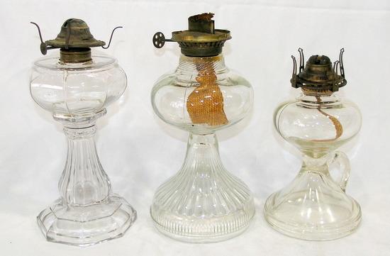 """Lot Of 3 Clear Glass Kerosene Table Lamps.  9-3/4"""", 10"""", 8""""."""