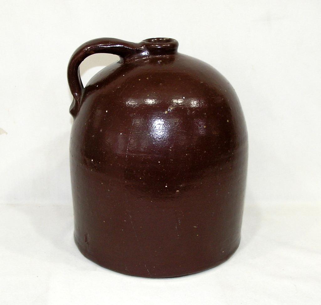 Vintage Large Stoneware Jug Reddish Brown In Color Unmarked. In Good Condit