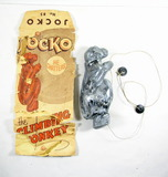 Vintage Jocko No. 85 Plastic Climbing Monkey. Works. Also original bag in P