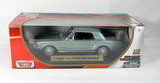 Diecast  Replica of a 1964 1/2 Ford Mustang by Motor Max.    1/18 Scale. Ne