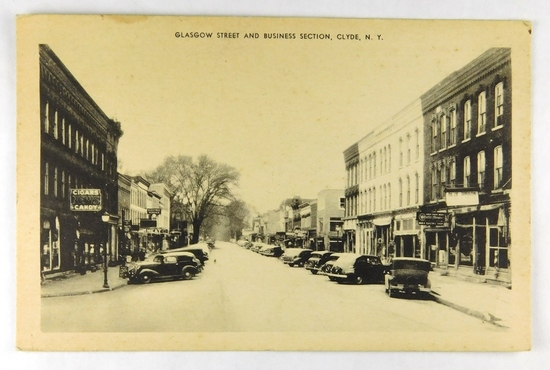 28.  RPPC:  1940's Snowy Day Glasgow Street and Business Section Clyde, NY
