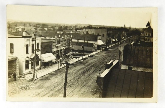 30.  RPPC:  c1908 elevated view of Pulaski, Wisconsin Main Street – Signs I