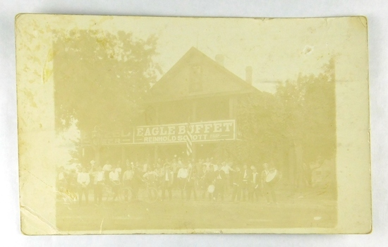 32.  RPPC:  1917 Large Band in front of Eagle Buffet –Reinhold Schott Prop.