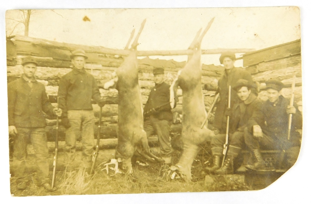 18.  RPPC:  c1916 E. Farrier Wisconsin Hunting Camp with a Pair of Trophy W