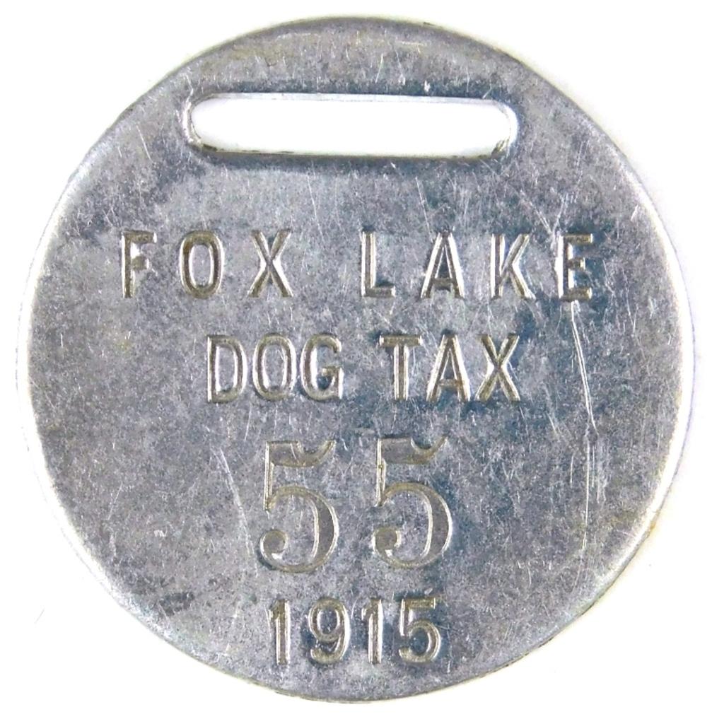 "74.  1915 Aluminum Fox Lake (Wisconsin) Dog Tax Tag #55.  SIZE:  1"".  CONDI"