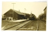 24.  RPPC:  c1912 Chicago & North Western Railway Depot with Engine 982 rol