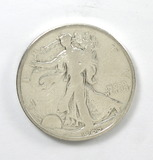 168.    1935    Walking Liberty Half Dollar