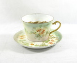 Vintage Porcelain Flowered Mustache Mug with Saucer.
