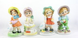 Grouping of 4 Miscellaneous Ceramic Statues. Made in Taiwan.