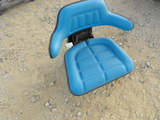 BLUE TRACTOR SEAT  ( HAS A SMALL TEAR)