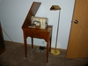 Singer Model 237 sewing machine in cabinet and curved neck floor lamp.
