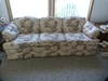 "Justice upholstered flowered couch. - 83"" L"