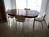 Oval enamel top table with chrome legs and one leaf.  - Howell Chrome Steel
