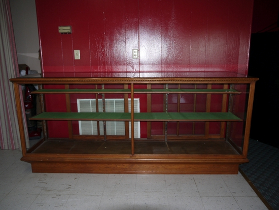 8 ft. Simmons oak display cabinet with sliding glass doors - 2 front & 1 side glass panels removed