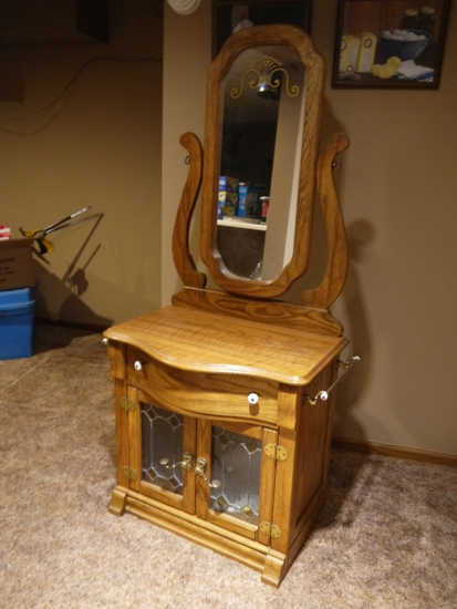 "Newer oak commode with mirror; 67-1/2"" T x 28-1/2"" W (w/towel bars) x 19"" D"