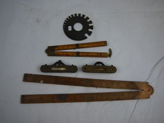(5) Tools: (2) folding rulers, (2) levels, wire gauge