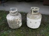 2 empty propane tanks