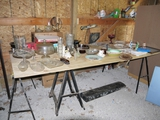 3 plastic sawhorses, sheet of plywood and everything on the plywood