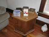 End table, 3 bibles, gospel CDs, Sigourney Belle pin