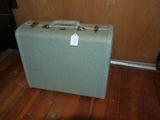 Samsonite off blue small suitcase
