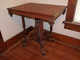 Fancy parlor table, top is split on top and has extra nails
