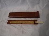 Wood trim slide rule, W.M. Cuddy name carved in wood, Pat. June 5, 1900, Keuffel & Esser Co.