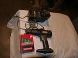 Craftsman 16.8 rechargeable drill with battery & charger and Craftsman drill bits