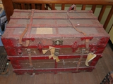 Large steamer style trunk with leather straps