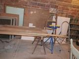 Step ladder, step stool, pair of sawhorses, lumber, roller stand