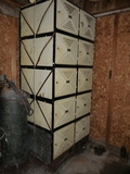 10 metal locker units, bottom pair are rusty, many with keys