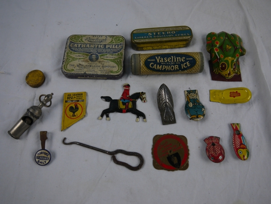 22 metal items: whistles, clickers, tins, button hook,