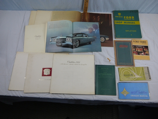 14 automobile manuals and promotional items