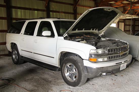 2004 Chevy Suburban, 188000 Mileage ? , White in color
