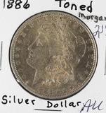 1886 - MORGAN DOLLAR - TONED AU