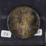 1994 - SILVER EAGLE - TONED GOLDEN