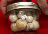 18 Stone Marbles in Jar