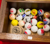 23 Advertising Marbles and 2 Wooden Nickels