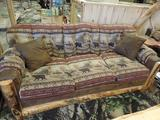 Aspen wood couch with upholstered bear & elk.