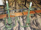 2 metal united bow stands.