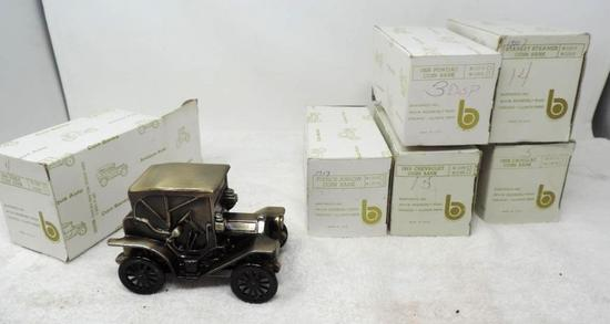 6 antique auto coin banks with boxes.
