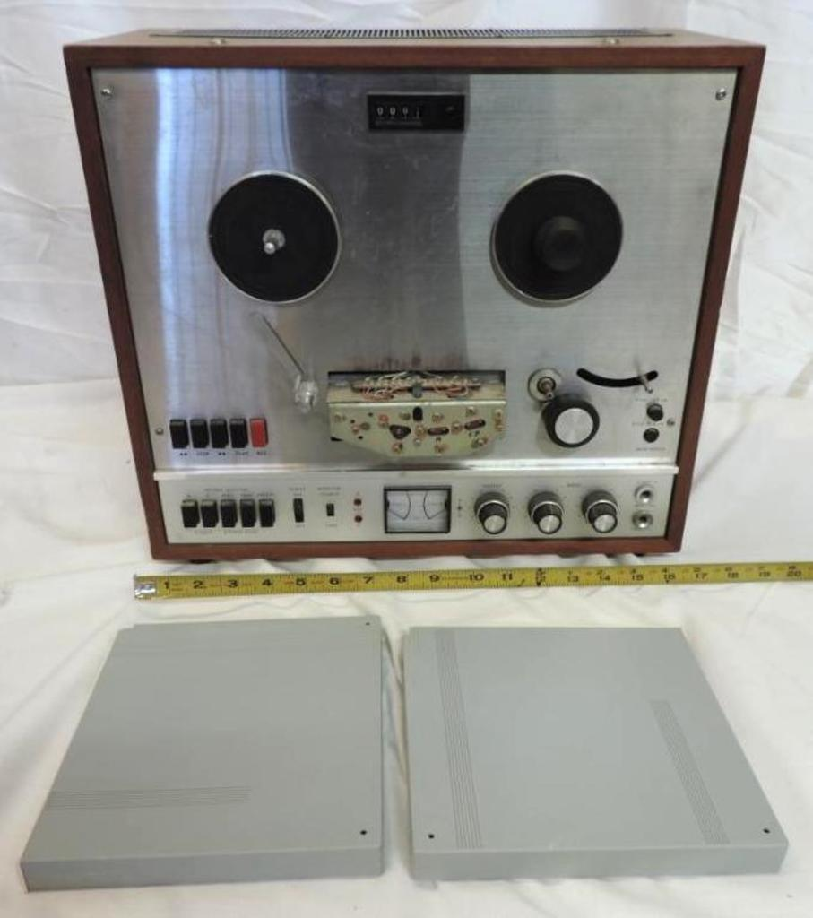 Teac model A-1200U reel to reel with 2 tapes.
