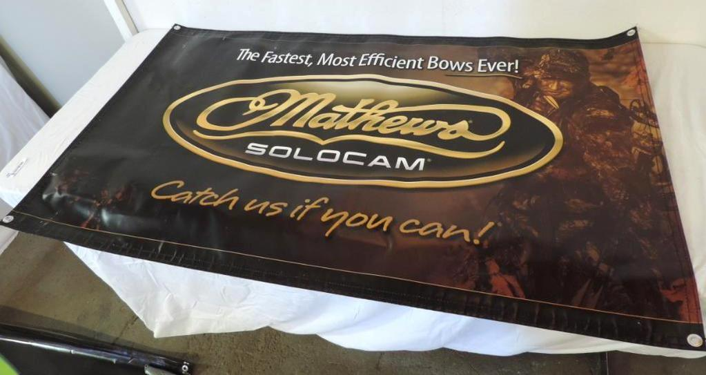 3 Mathews Solocam man cave bowhunting advertising signs.